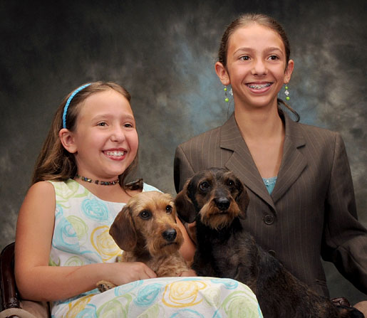 Maddie and Danielle with their Dachshunds